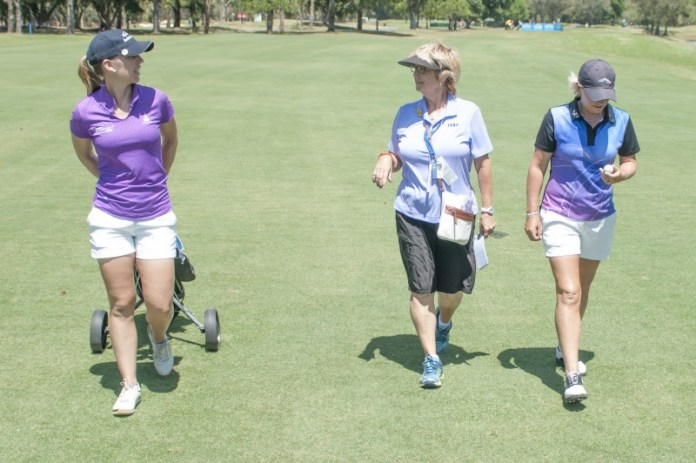 Former LPGA player Jane Crafter is out and about on the course and chats with Sally and Becky as they walk up the fairway