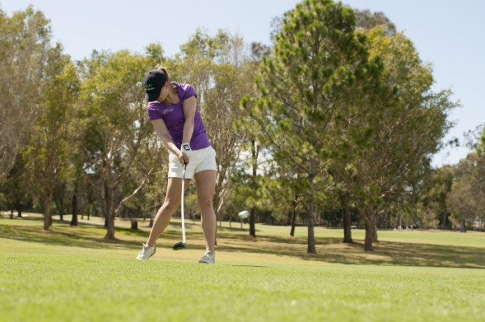 Sally making clean contact and keeping the head perfectly still through the swing launching the ball towards the green