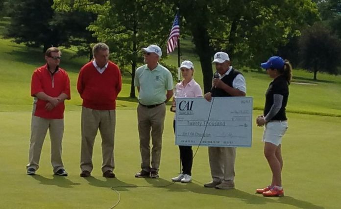 Champion Alejandra Llaneza accepts her $20,000 Championship check from the PA Women's Open Tourney staff.