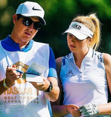 Olivia Cowan with caddy Ben Brewer
