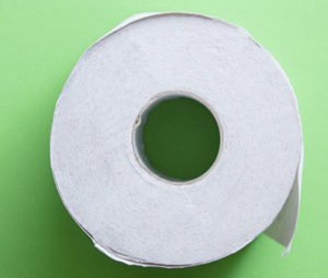 A Roll Of Toilet Paper On A Green Background For A Poop Story