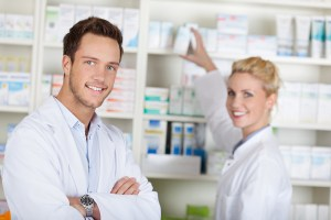 Smiling pharmacy technicians