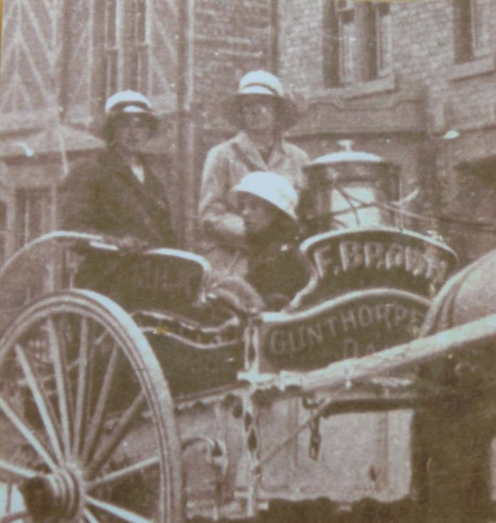 Close up of two land girls delivering milk in horse-drawn cart for Frederick Brown, Gunthorpe, Peterborough c1917
