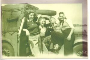 Betty Dugdale in Women's Land Army truck with friends