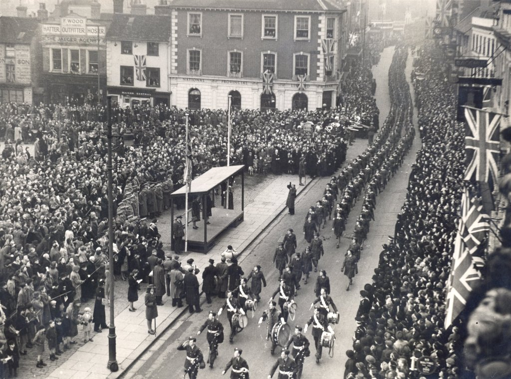 Bedfordshire land girls march past Princess Elizabeth down Bedford High Street on 14 February 1946 in a Victory parade