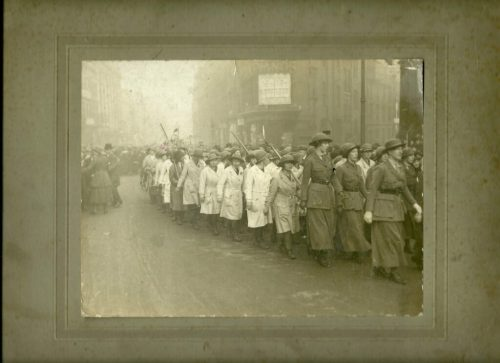 """Elise's caption for the photo: """"Woman's (sic) Land Army 1917. Rally, at Birmingham, going to see the Whip. Me!!! 5th Land Girl on the left."""""""