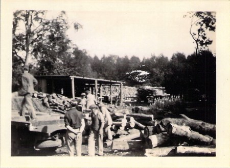Timber yard and part of sawmill at Haley's Mill, Cirencester. Max in cap in front of lorry.