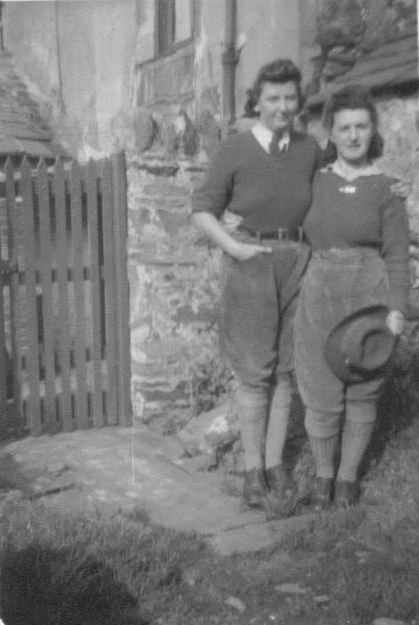 Gwyneth Mary Edwards (left standing) with her friend Megan (standing right).