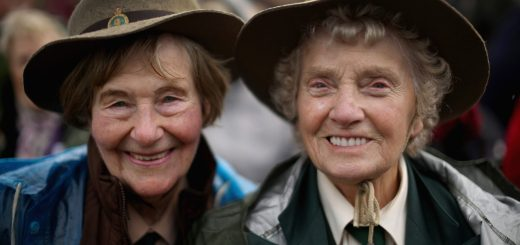 STAFFORD, ENGLAND - OCTOBER 21: Former Land Girls Iris Halfpenny (L) and Iris Newbould smile as they brave the high winds during the dedication ceremony of the new memorial to honour women who served in the Land Army during World War Two at The National Memorial Arboretum on October 21, 2014 in Stafford, England. The new bronze memorial, depicting a Land Girl and Lumber Jill was unveiled by Sophie, Countess of Wessex, with the ceremony being attended by more than 400 former Land Army girls. (Photo by Christopher Furlong/Getty Images)