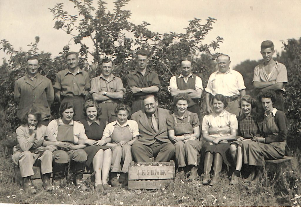 Mary pictured with other Land Girls and farmers on a fruit farm in Essex