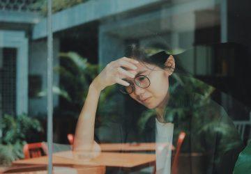 Worried woman sitting alone