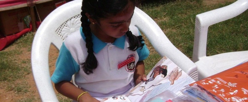 A_girl_reading_a_book_-_Flickr_-_Pratham_Books_(1)