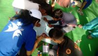 volunteering-with-kids-on-water