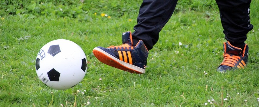 child learning football