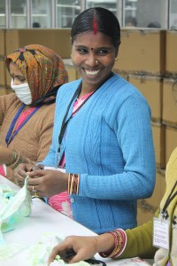 India-Women-Factory-Workers-Smiling-In-Blue