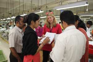 Cathleen Tobin conducting research at a garment factory