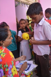 A Tejasvi account holder pulls out cash from his piggy bank to deposit with the financial counselor