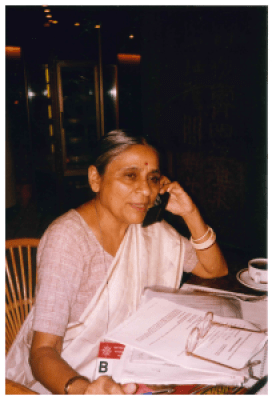 Ela Bhatt speaking on a cellphone during Fourth World Conference on Women NGO Forum (Beijing, 1995)