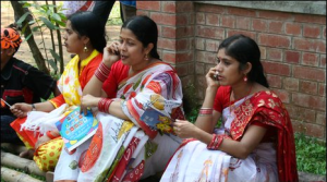 Bangladeshi women on their cellphones (Photo courtesy of GlobeOne)