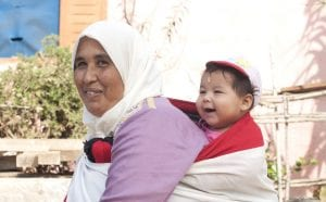 A health microinsurance client from Morocco with her youngest child