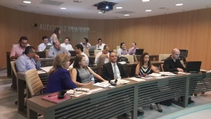 Exchange participants sit for a formal presentation at Fundación delamujer's head office