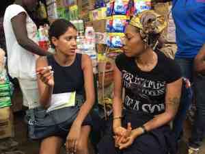 A Women's World Banking staff member speaks with a Nigerian women entrepreneur