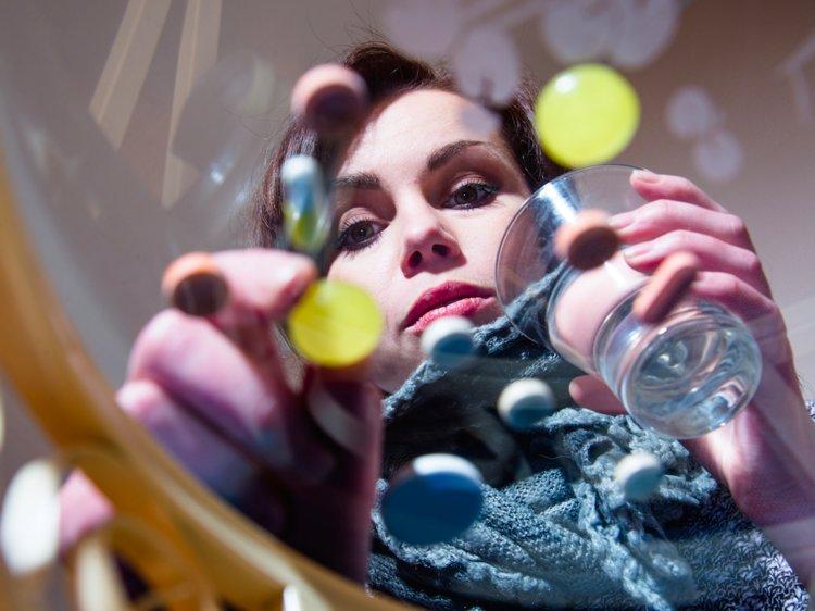 Woman taking Magnesium and Vitamin D3  capsules
