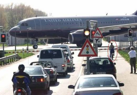 Aeroplane crossing a road