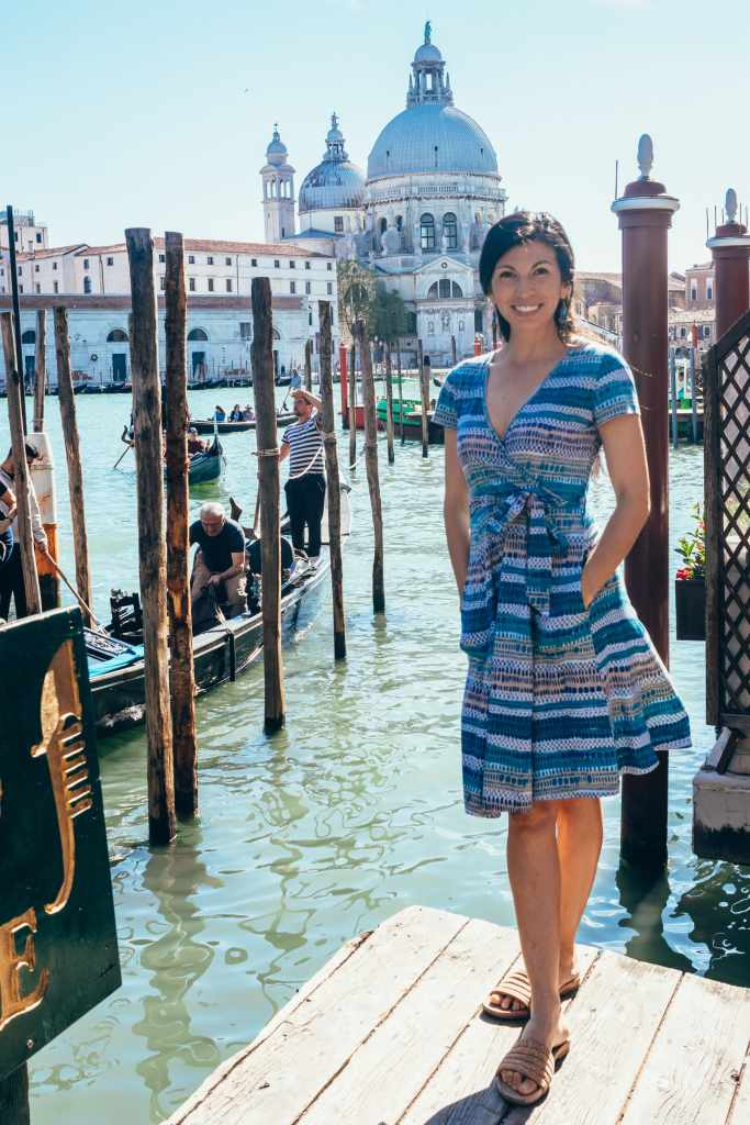 Women standing near water in Venice Italy wearing Nomad's Clothing UK