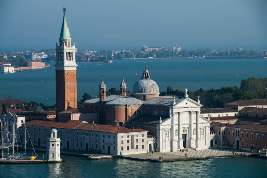 A front view of the Church of San Giorgio Maggiore is seen from a vantage point in Venice Italy.