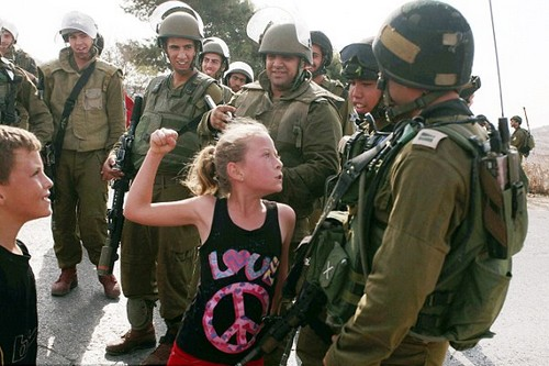Palestinian girl reacts after Israeli forces