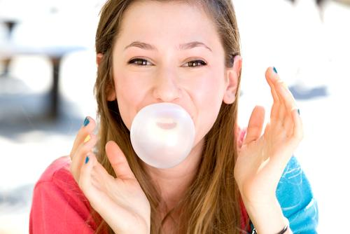 Young Girl Blowing A Bubblegum