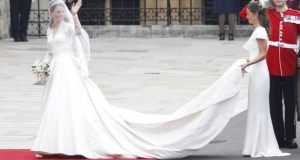 The long sleeve wedding dress, worn by Kate Middleton