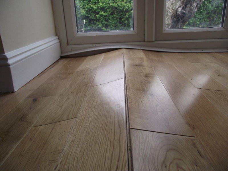 Warped Floorboards Caused By Humidity Swings Woodfloordoctor Com