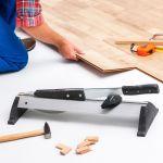 32102147 – carpenter worker installing laminate flooring in the room