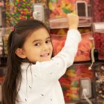 42271773 – girl at candy counter in supermarket