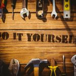 42549283 – the word do it yourself against desk with tools