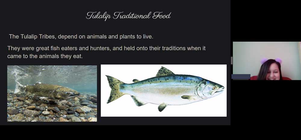 Tulalip traditional food, showing how the tribes depend on animals and plants to live, showing a salmon underwater and a drawing of a salmon.