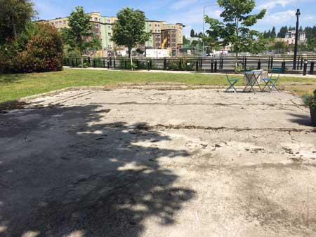 Empty lot with foundations of previous building still showing