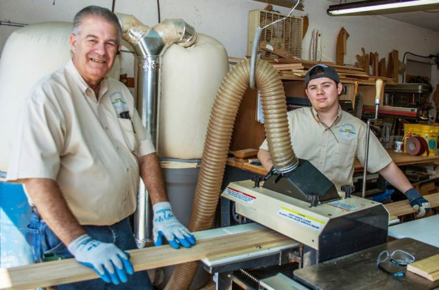 """Meet woodworker, Dave McPherson, (left) and his workshop assistant, Colby Rojas. Working together, they turn out a ton of molding. """"We've done 25% more business in the first three months of this  year than we did all last year,"""" says Dave."""