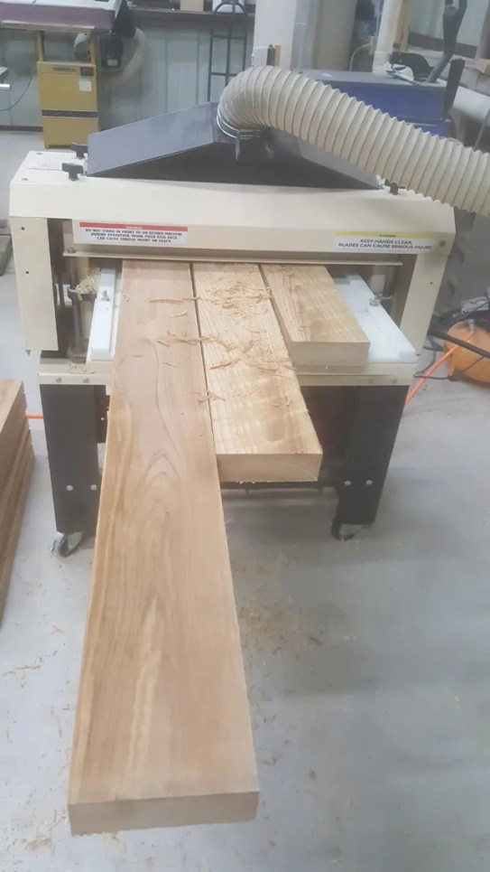 "Jeff snapped this photo as he dimensioned rough-sawn 2x6 cypress boards to build the louvered shutter panels in the photo above. Note his 25"" Woodmaster handles 3, 2x6's in one pass easily."