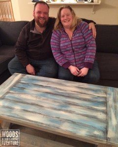 Paul and Shawna Woods in front of our signature Farm Style Coffee Table. See our Rustic Furniture and other items in the shop.