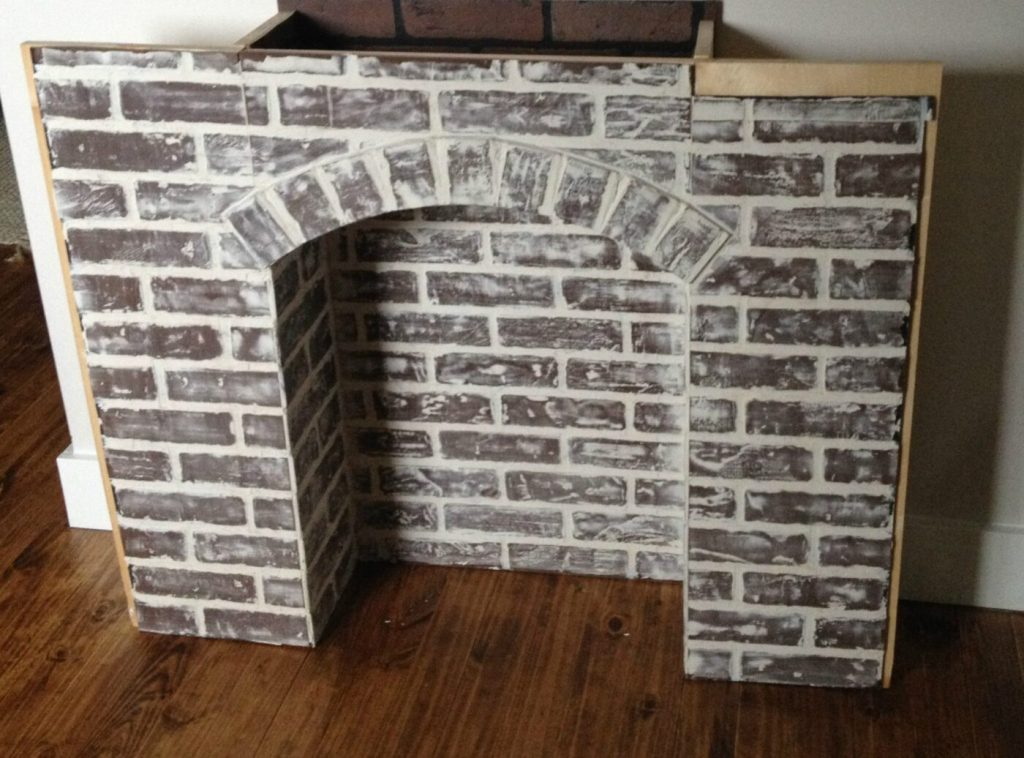 if you 39 re going to make it you better fake it diy fake brick fireplace. Black Bedroom Furniture Sets. Home Design Ideas