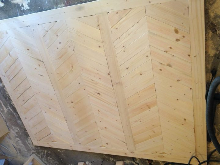 Chevron wood pieces added to Mudroom built in wall backer