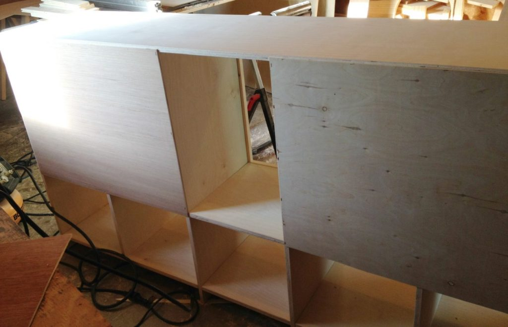 Staple plywood backer onto DIY storage console cabinet