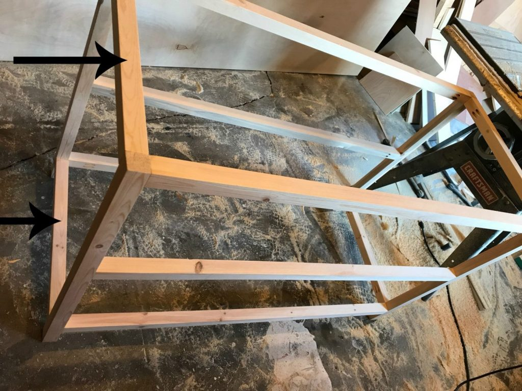 Attach front and back frames of X base console table together