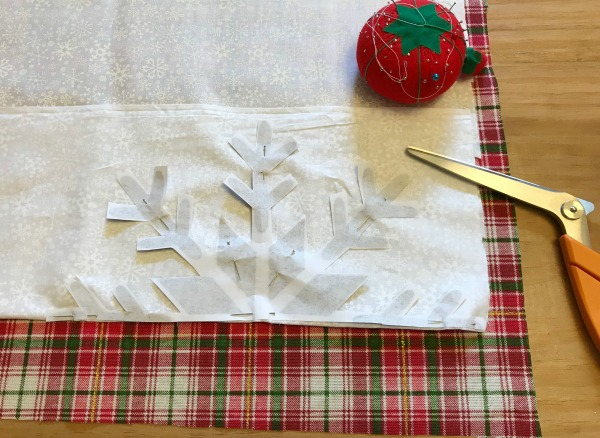 How to make a DIY snowflake pillow with a paper template