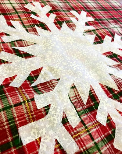 Stitch snowflake onto DIY snowflake pillow