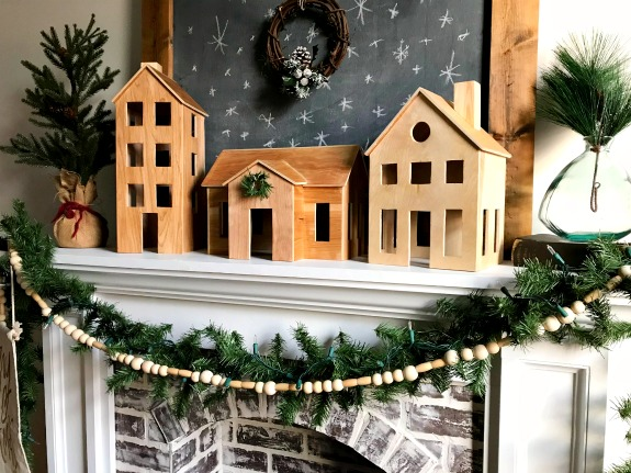 DIY Wooden Christmas Village Display perfect for a simple Scandinavian Christmas Mantle