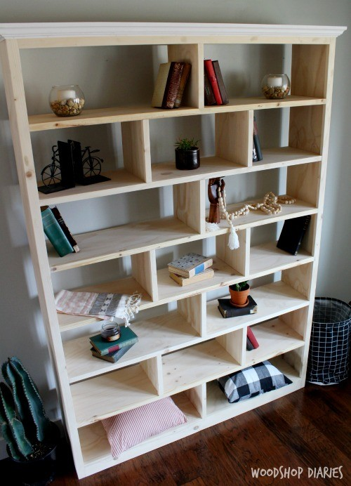 DIY unfinished stand alone bookshelf with offset shelf dividers